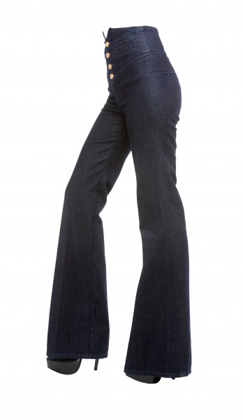 Young woman legs with bell bottom jeans and platform stilettos
