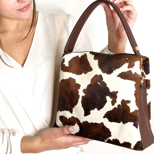 Sondra Robert Cowprint faux suede print bucket with detachable strap. At Helen Ainson in Daien CT Handbag by sondra roberts